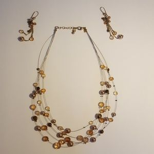 Gold colored beaded necklace and earring set